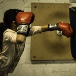 "Brian Wolfe, ""Jab,"" young athlete taking aim at the heavy bag. Newburgh Boxing Club, Newburgh, NY."